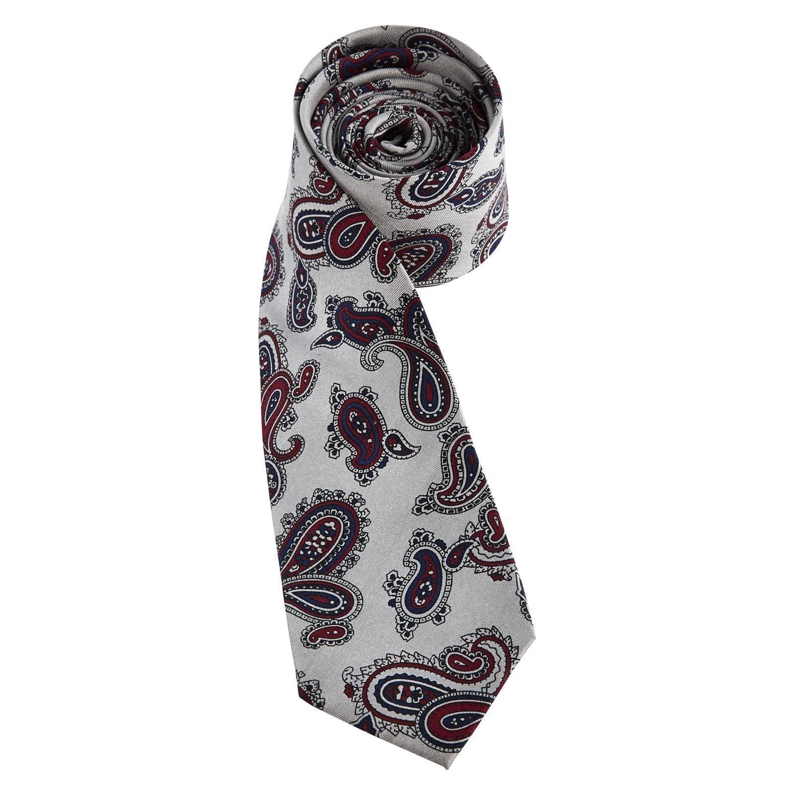 Галстук WellingАксессуары<br>Пижонский, узкий галстук унисекс из натурального шелка с классическим огуречным узором &amp;amp;quot;pasley&amp;amp;quot; великолепно подчеркнет официальный образ на строгой встрече, придав наряду щепотку изысканности и благородства. Также может носиться с V-neck трикотажем в smart casual луке. Особым писком будет соединить его с аналогичного орнамента хлопковой рубашкой Hull из той же коллекции. Если вы решили использовать его с костюмом, то, предпочтительно, выбирайте черный или темно-серый цвет пиджака.<br><br>Артикул: 1014214<br>Материал: 100% шёлк<br>Цвет: серый<br>Пол: Унисекс