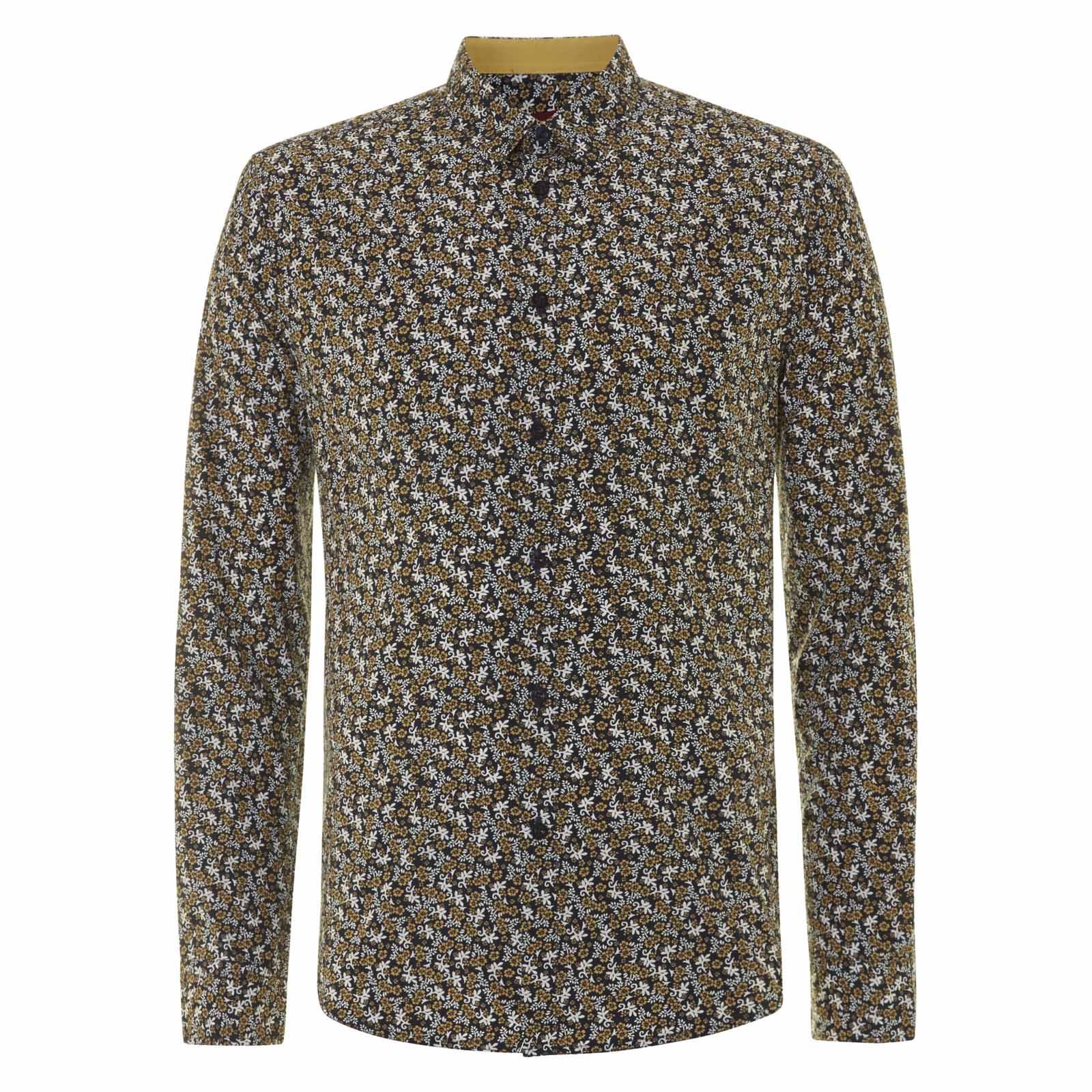 Рубашка AshtonС длинным рукавом<br>Приталенная мужская рубашка с классическим отложным воротником, украшенная  традиционным для английского дизайна сплошным двухцветным цветочным принтом.  Можно  равнозначно носить как заправленной в брюки, для чего рубашка имеет удлиненный задник, так и навыпуск – к этому располагает фигурный контур спереди.  Приятной деталью служат  желтые прямоугольные вставки на кончиках манжет, служащих застежкой для пуговиц. Этот декоративный элемент повторяется в виде выточек, венчающих боковой шов снизу. Такая рубашка будет отличным дополнением к базовому кардигану на пуговицах или прилегающему пиджаку.<br><br>Артикул: 1514203<br>Материал: 100% хлопок<br>Цвет: синий с цветочным принтом<br>Пол: Мужской